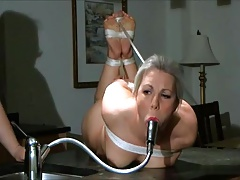 female ball-gagged with faucet