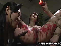 Pouring wax on her humid vulva..
