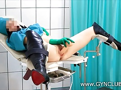 Dark-haired nurse masturbates in..