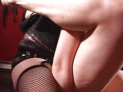 2 Dominatrixes with strapons