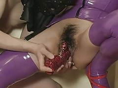 Japanese wearing latex mask gets..