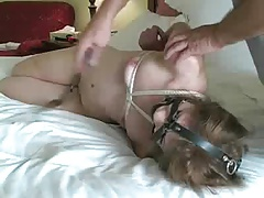 Bare cute bound on bed